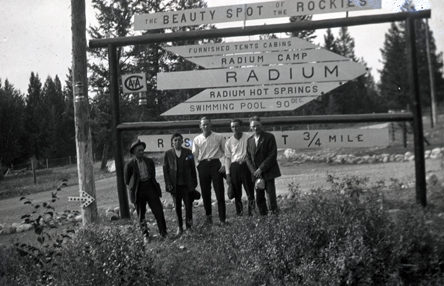 Standing under the Radium Hot Springs sign